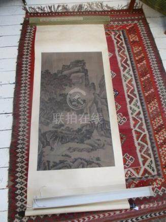 A 20th century Chinese picture scroll of a rocky landscape with a waterfall, trees and figures,