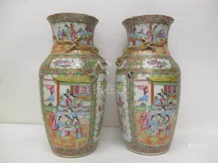 A pair of late 19th century Chinese Canton vases with a folded neck, decorated with a dragon in