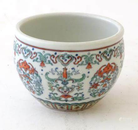 A Chinese doucai bowl, with scrolling foliage and flower decoration.