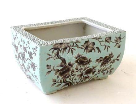 A Chinese turquoise oblong planter decorated with black cherry blossom and peonies,