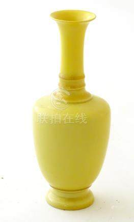 """A Chinese yellow glazed baluster vase with an elongated neck and flared rim. Approx. 5 3/4"""" high."""