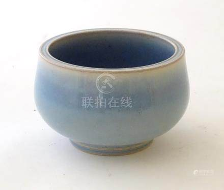 """An unmarked high fired blue glazed bowl. Approx. 3"""" high."""