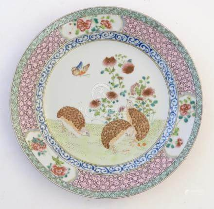 A Chinese famille rose plate decorated with three quails, a butterfly and peonies,