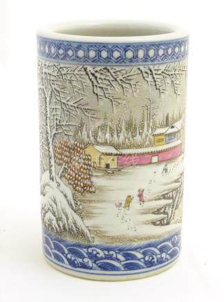 A Chinese famille rose brush pot depicting a winter/snowy landscape,