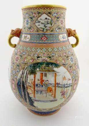 A large Chinese famille rose 'Niutou Zuo' twin handled vase,