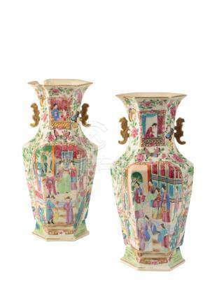 A PAIR OF CANTON FAMILLE ROSE HEXAGONAL BALUSTER VASES