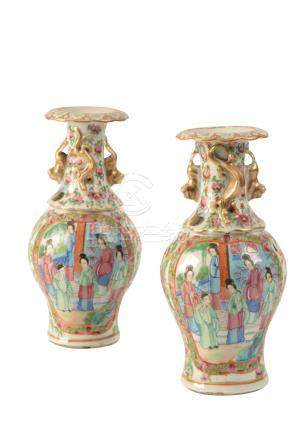 A PAIR OF CANTON FAMILLE ROSE BALUSTER VASES