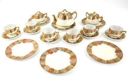 Japanese Satsuma egg-shell tea set for six by Moshida, the teacups with lithophanes to the base,