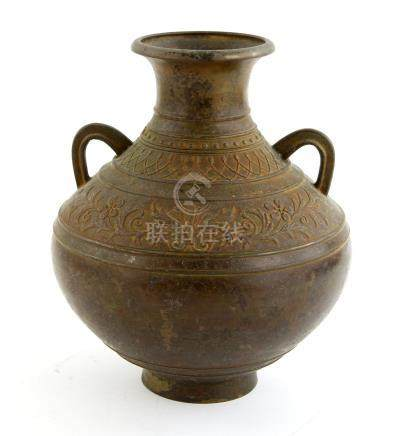 Japanese bronze twin-handled vase with moulded floral and foliate decoration, on round foot,