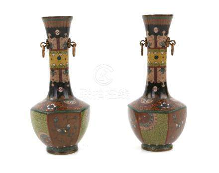 Pair of Japanese cloisonne vases decorated with butterflies, flowers and foliage, with twin ring
