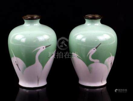 Pair of 20th century Japanese cloisonné vases decorated with egrets, on light green ground, mark