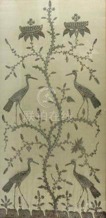 Eastern embroidery of four cranes on and amongst a flowering shrub, in silver coloured metallic