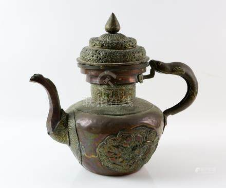 Tibetan copper and brass coffee pot and cover with fish handle and applied panels of decoration,