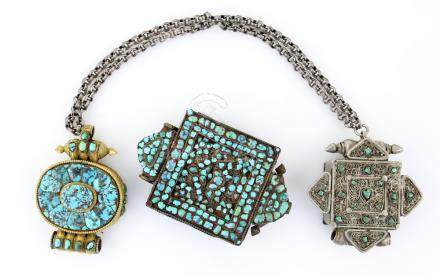 Tibetan brass and turquoise mounted amulet box, 8cm long, and two others with similar decoration, (