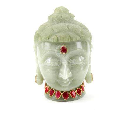 Carved aventurine head of Buddha, set with synthetic rubies to the forehead and around the neck,