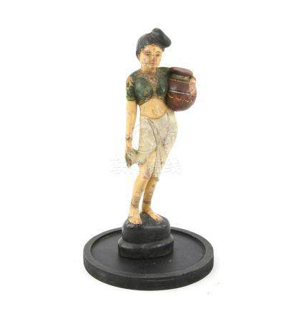 Indian rubber polychrome figure of a Bengali girl carrying a lota (clay water jar), Colonial