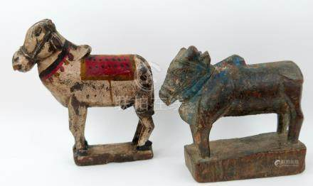 Indian carved wood Brahma bull 17cm high and another 20cm high