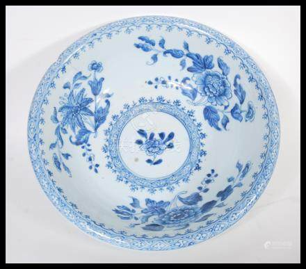 A 19th Century Chinese porcelain bowl having hand painted blue and white decoration depicting floral