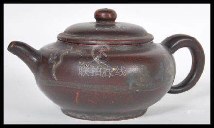 A 19th Century Chinese pottery Yixing teapot having hand painted decorated decoration depicting bats