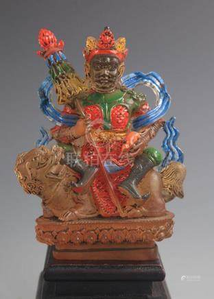 A COLOR AND GILT GLASS TREASURE KING STATUE