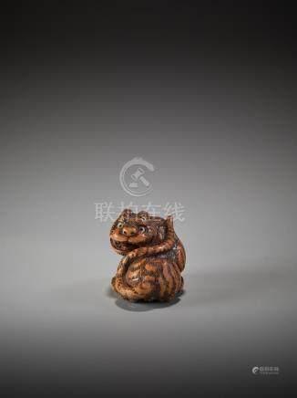 A WOOD NETSUKE OF A TIGER BY TANAKA MINKO (1735-1816)