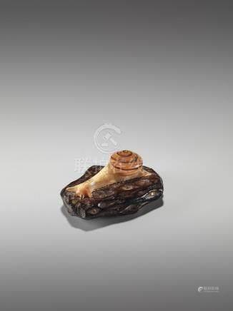 AN INLAID WOOD NETSUKE OF A SNAIL BY GYOKKEI