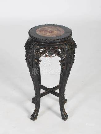 A Chinese dark wood jardiniere stand, Qing Dynasty, the circular top with mottled red marble