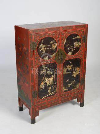 A Chinese red lacquer side cabinet, Qing Dynasty, the rectangular top with incised decoration of