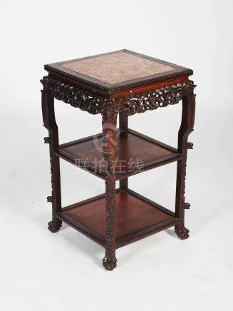 A Chinese dark wood jardiniere stand, late Qing Dynasty, the square top with a mottled red marble