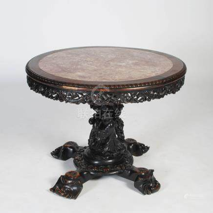 A Chinese dark wood round table, Qing Dynasty, the circular top with mottled red marble insert above