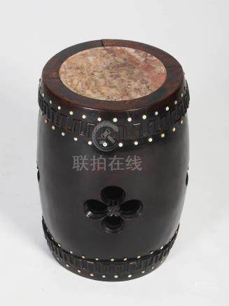 A Chinese dark wood and mother of pearl inlaid barrel shaped stool, Qing Dynasty, the circular top