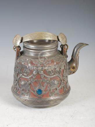 A Chinese pewter mounted yixing teapot and cover, the mounts cast with pairs of dragons and