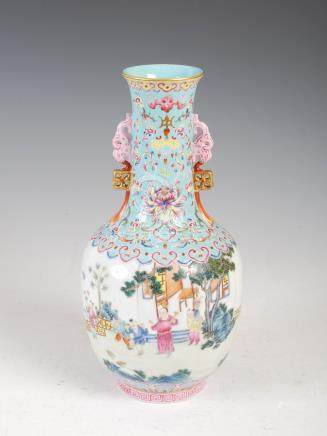 A Chinese porcelain turquoise blue ground famille rose twin handled bottle vase, Qianlong seal