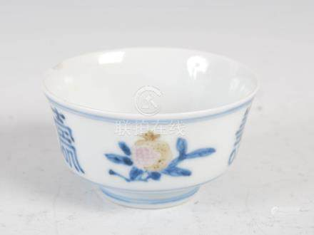 A small Chinese porcelain blue and white bowl, decorated with finger citrus, peach and pomegranate