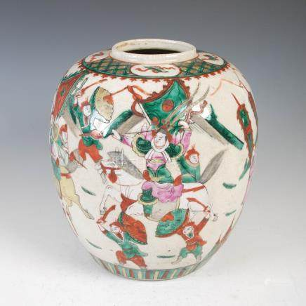 A Chinese porcelain crackle glazed jar, Qing Dynasty, decorated with warriors, within diaper and
