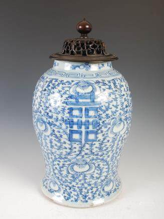 A Chinese porcelain blue and white jar and wood cover, Qing Dynasty, decorated with Shou characters,