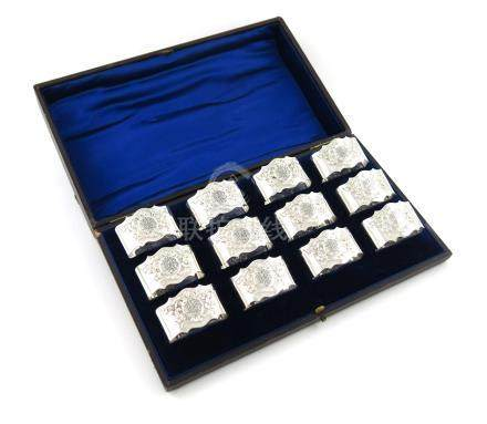A set of twelve Edwardian silver napkin rings, by Jackson and Fullerton, London