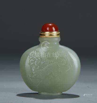 A nice carved celadon jade snuff bottle