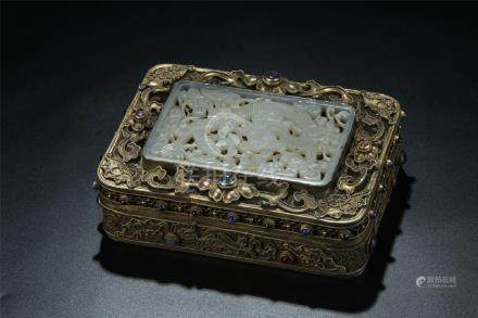 A gilt silver filigree mounted white jade plaque on top