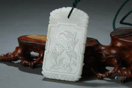A nice low relief carved white jade plaque