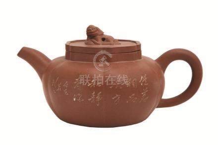 A YIXING POTTERY TEA POT