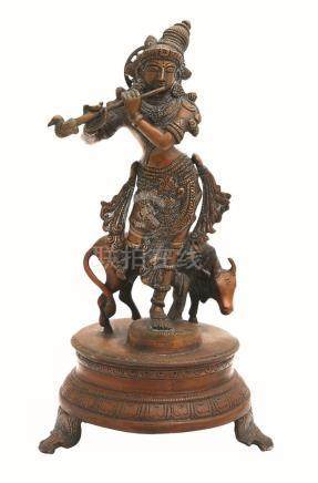 A BRONZE FIGURE OF KRISHNA AND A BULL