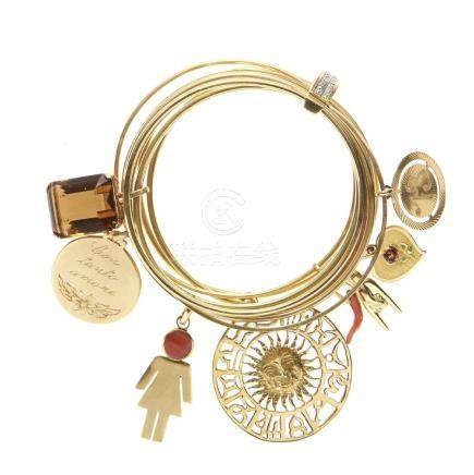 Gold and charm bangle bracelet