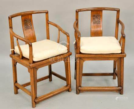 Pair of Chinese armchairs with carved back panel. ht. 35 in.