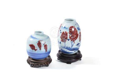 Two Chinese modern ovoid vases painted in blue and terracotta with birds in landscapes