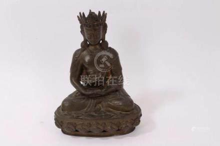 Antique Tibetan bronze Buddha in seated...