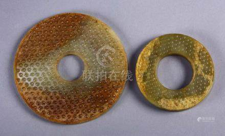 (lot of 2) Chinese archaistic hardstone bi-discs, each with a comma pattern in relief on both sides,