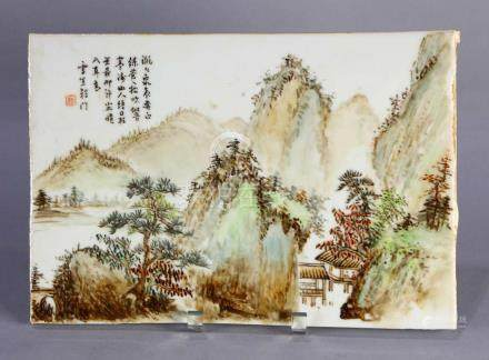 Chinese porcelain plaque, featuring a mountainous landscape along a river, and scholars in a viewing