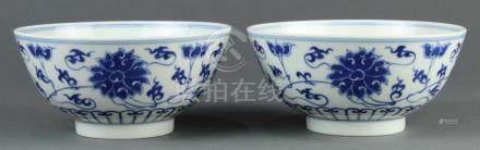Pair of Chinese underglaze blue porcelain bowls, exterior decorated with lotus scrolls, base with