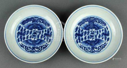 Pair of Chinese underglaze blue porcelain dishes, featuring phoenix amid clouds to the interior